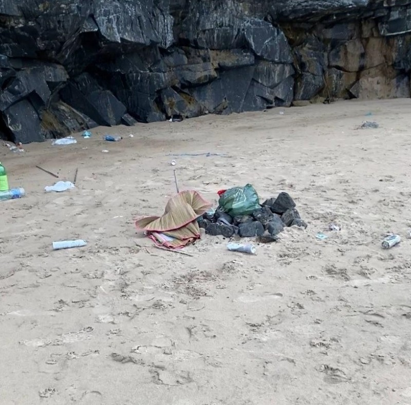Discarded belongings, rubbish, plastic bottles and bags left on Castlerock Beach.