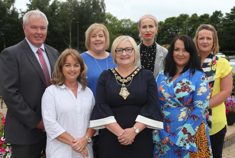 Staff and volunteers from Limavady Community Development Initiative pictured with the Mayor of Causeway Coast and Glens Borough Council Councillor Brenda Chivers along with Elaine Downey and Harry Armstrong from Department for Communities who part fund the advice service provision.