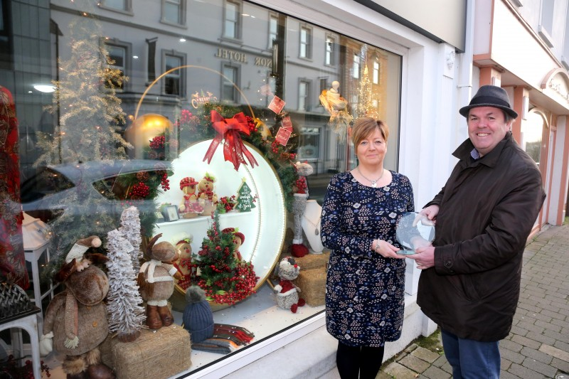 The Style Loft on Main Street in Ballymoney was the winner of Causeway Coast and Glens Borough Council's Christmas window competition in Ballymoney. Lynda McHenry is pictured receiving the award from Town and Village Officer Shaun Kennedy.