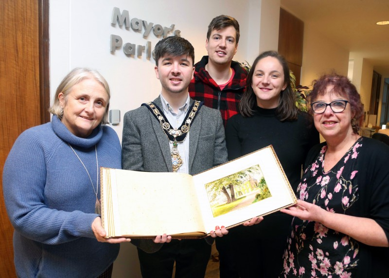 The Mayor of Causeway Coast and Glens Borough Council Councillor Sean Bateson recently received the illuminated address book at an event held in Cloonavin. Included in the picture are Sue McLaughlin, Connie Kelly, and Causeway Coast and Glens Borough Council's Museum Services Development Manager Helen Perry. The book is now set to go on display in Coleraine Museum.