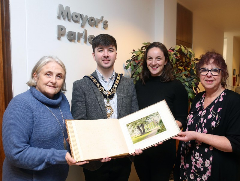 The Mayor of Causeway Coast and Glens Borough Council Councillor Sean Bateson recently received the illuminated address book at an event held in Cloonavin. He is pictured with Sue McLaughlin, Connie Kelly and Council's Museum Services Development Manager Helen Perry. The book is now set to go on display in Coleraine Museum.