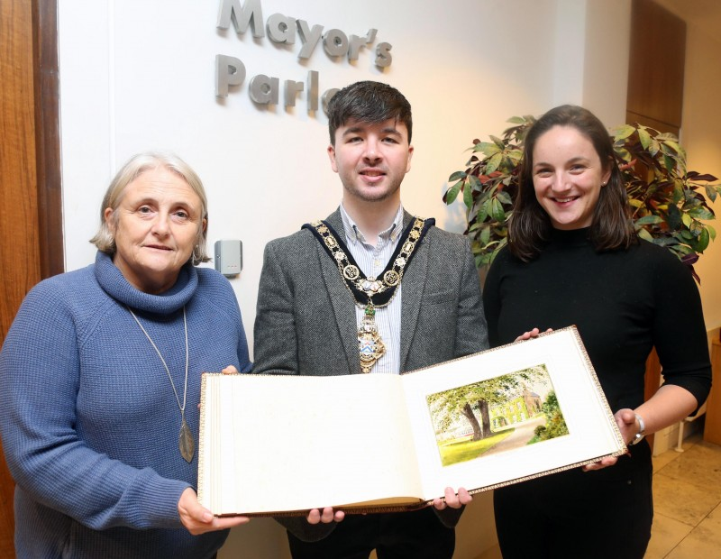 The Mayor of the Causeway Coast and Glens Borough Council Councillor Sean Bateson is pictured with guests including Sue McLaughlin and Connie Kelly at the handover of the illuminated address book.
