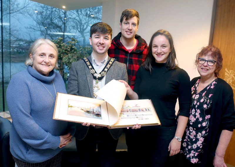 The Mayor of Causeway Coast and Glens Borough Council Councillor Sean Bateson recently received the illuminated address book at an event held in Cloonavin. Included in the picture are Sue McLaughlin, Connie Kelly and Causeway Coast and Glens Borough Council's Museum Services Development Manager Helen Perry. The book is now set to go on display in Coleraine Museum.