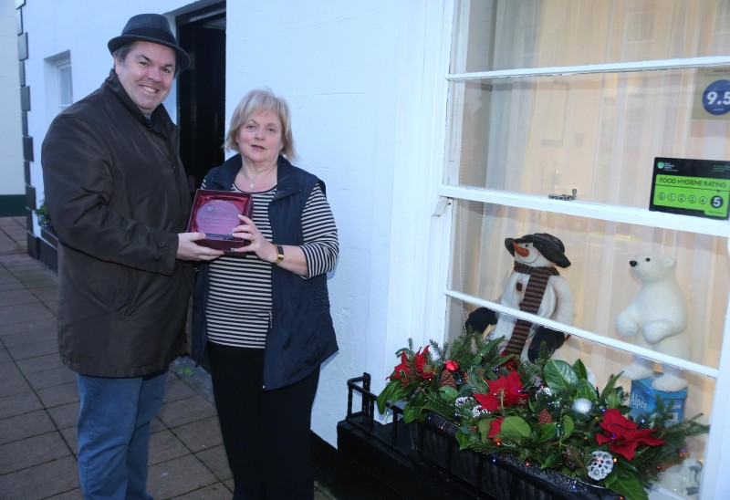 Riverside B&B on Mill Street Cushendall was the winner of the Causeway Coast and Glens Borough Council's Christmas window competition in Cushendall. Anne McKeegan is pictured receiving the award from Town and Village Officer Shaun Kennedy.