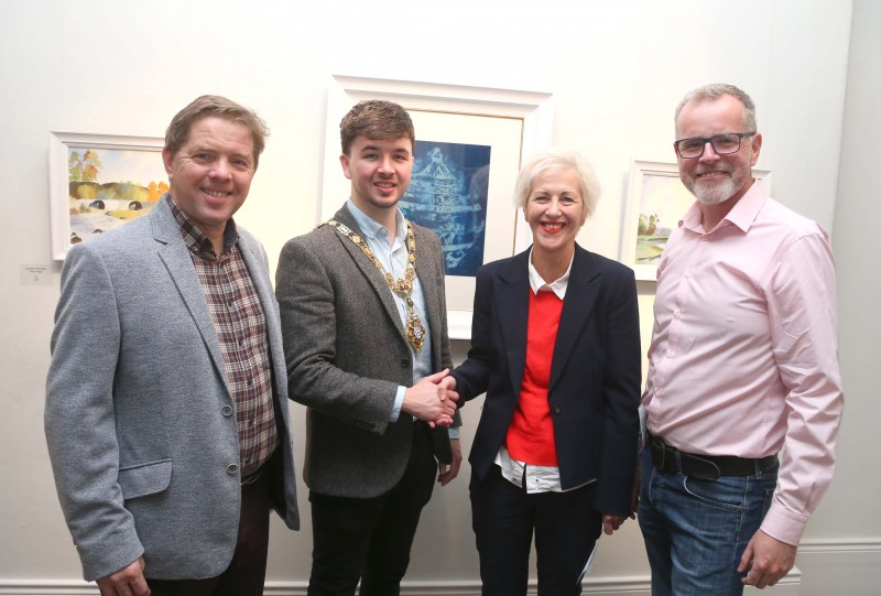 The Mayor of Causeway Coast and Glens Borough Council Councillor Sean Bateson pictured with Raymond Kennedy, Guest Judge at Coleraine Art Society exhibition launch, Heather Bryne, award winner for her painting 'Homeward' and Kevin McClelland, Coleraine Art Society Chairperson.