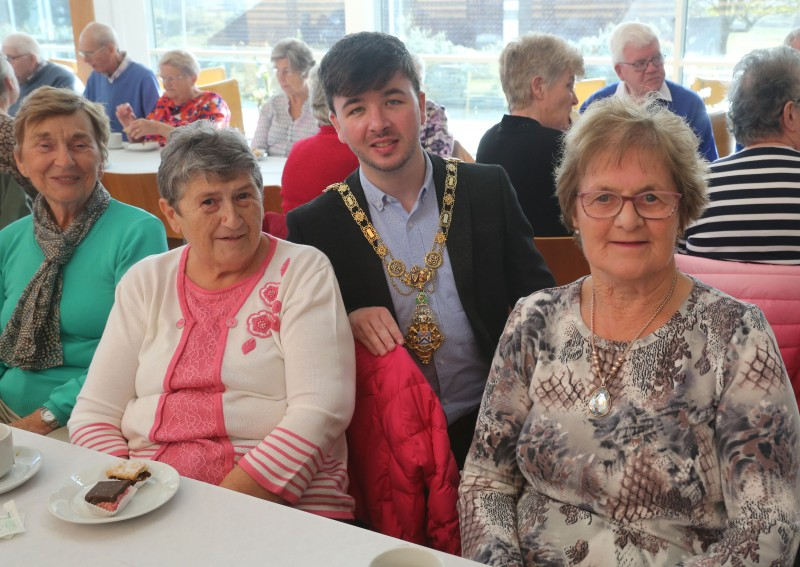 The Mayor of Causeway Coast and Glens Borough Council Councillor Sean Bateson pictured with Ballymoney Evergreen Club members Elizabeth Anderson, Peggy Brogan and Phyllis Kerr at a civic reception in Cloonavin.