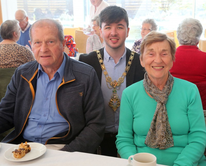 The Mayor of Causeway Coast and Glens Borough Council Councillor Sean Bateson pictured with Robert and Elizabeth Anderson at a civic reception for Ballymoney Evergreen Club members.