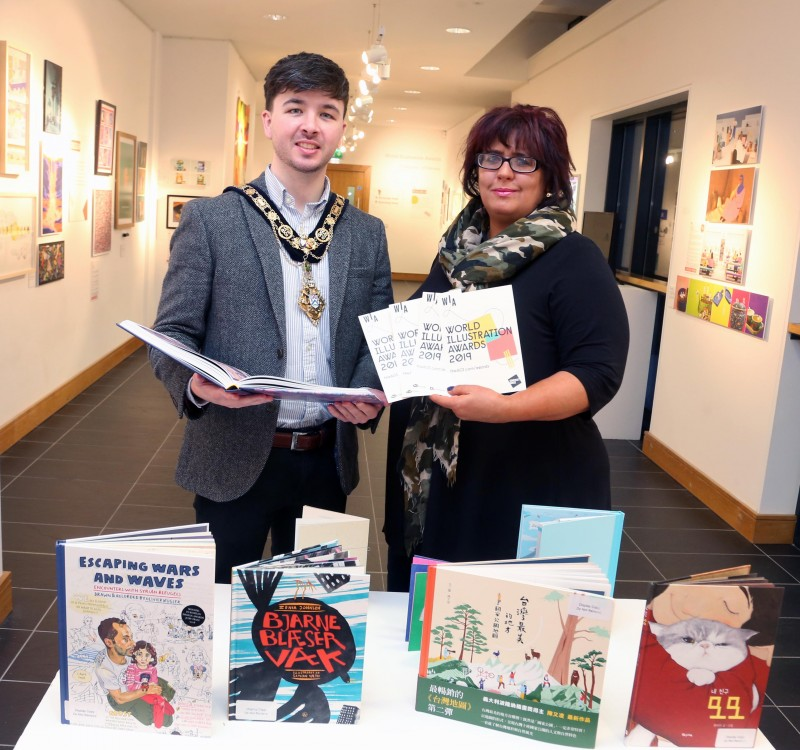 The Mayor of Causeway Coast and Glens Borough Council Councillor Sean Bateson pictured with Arts Marketing and Engagement Officer Lesley Cherry during his recent visit to Roe Valley Arts and Cultural Centre to view the World Illustration Awards exhibition.