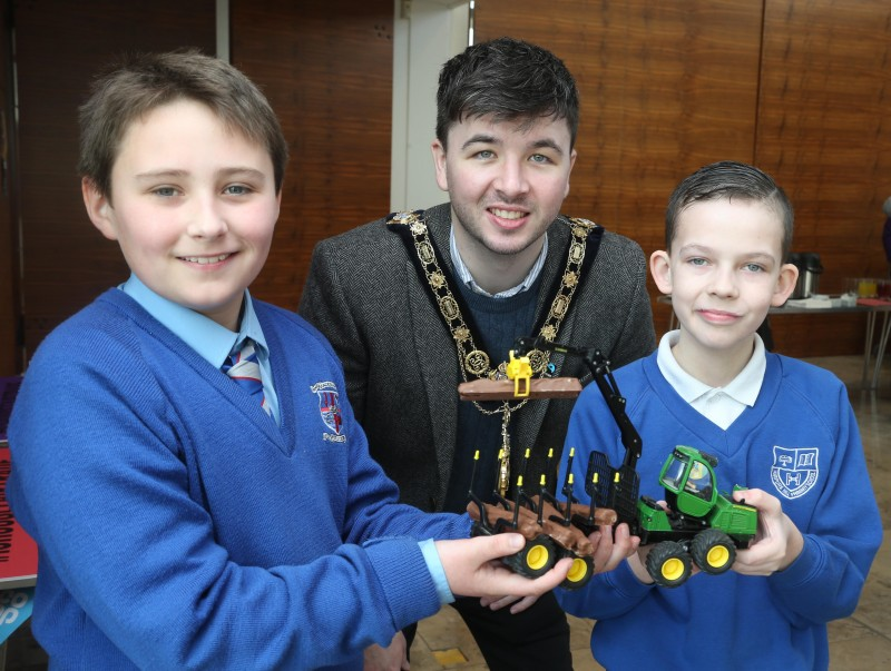 The Mayor of Causeway Coast and Glens Borough Council Councillor Sean Bateson pictured with Jenson McNeill and Junior Skinner with one of the creative entries in the Fairtrade Bake-Off.