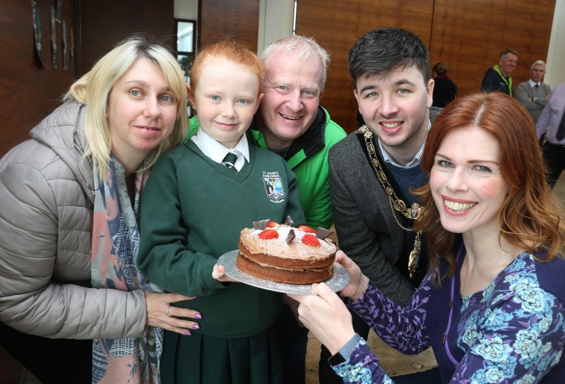 Cara Orr from St John's Primary School in Coleraine pictured with her parents Michelle and John, the Mayor of Causeway Coast and Glens Borough Council Councillor Sean Bateson and Fiona Watters, Causeway Coast and Glens Borough Council Fairtrade Group member, at the Fairtrade Bake-Off.