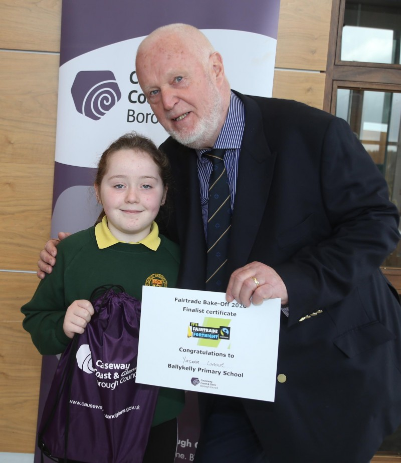 Yasmin Lanout from Ballykelly Primary, winner of the Junior Fairtrade Bake-Off, receive her certificate from Fairtrade Steering Group member Chris McCaughan.