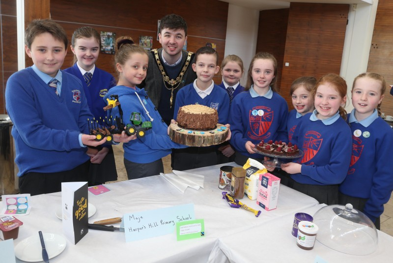 The Mayor of Causeway Coast and Glens Borough Council Councillor Sean Bateson pictured with pupils from Macosquin Primary School, Garryduff Primary School and Harpur's Hill Primary School at the Fairtrade Bake-Off celebration event in Cloonavin.