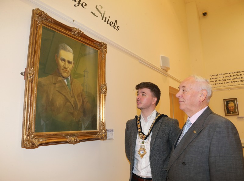 The Mayor of Causeway Coast and Glens Borough Council Councillor Sean Bateson pictured with Mac Pollock from Ballymoney Drama Festival as they admire the original George Shiels portrait by Jack Wilkinson on loan from the Abbey Theatre in Dublin.