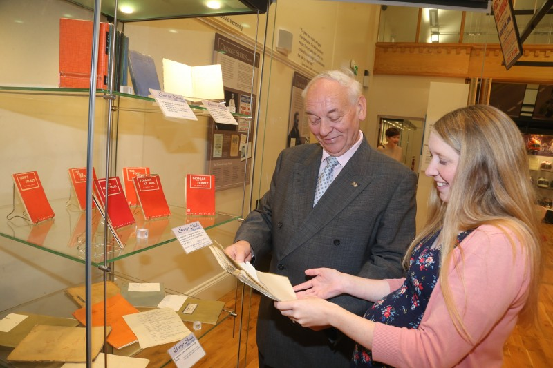 Mac Pollock from Ballymoney Drama Festival pictured looking at an original script belonging to George Shiels with Jamie Austin, Museum Officer, Causeway Coast and Glens Borough Council.