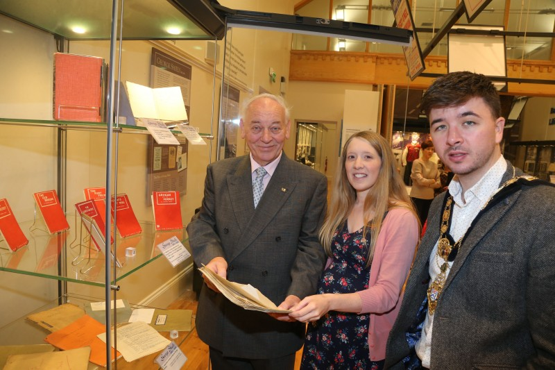 The Mayor of Causeway Coast and Glens Borough Council Councillor Sean Bateson pictured with Mac Pollock from Ballymoney Drama Festival and Jamie Austin, Museum Officer, Causeway Coast and Glens Borough Council at the George Shiels exhibition currently on display at Ballymoney Museum.