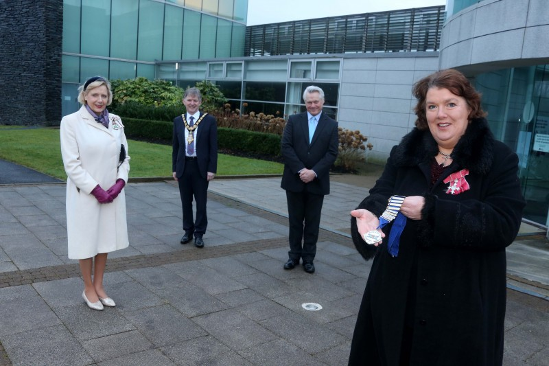The new High Sheriff of County Londonderry, Paula McIntyre MBE, accepts the Chain of Office at Cloonavin as the Lord Lieutenant of County Londonderry Alison Millar, Mayor of Causeway Coast and Glens Borough Council, Alderman Mark Fielding, and the outgoing High Sheriff Ross Wilson, look on.