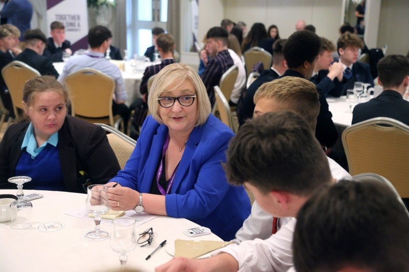 Councillor Brenda Chivers pictured with pupils from local secondary schools at the annual 'Let's Talk' event at The Lodge Hotel in Coleraine.