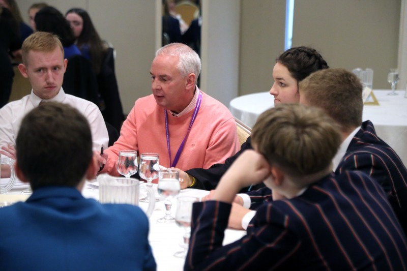 Councillor Dermot Nicholl pictured with pupils from local secondary schools at the 'Let's Talk' event organised by Causeway Coast and Glens Good Relations Department.