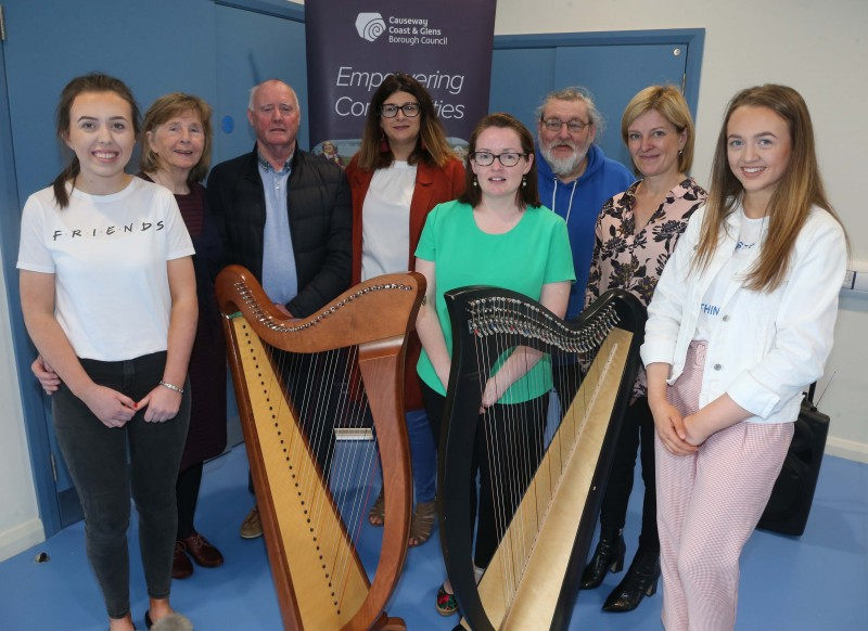 Committee members from the Magilligan Community Association pictured with harpists Dervla and Laura Bradley at the official opening of the new community centre in Magilligan.