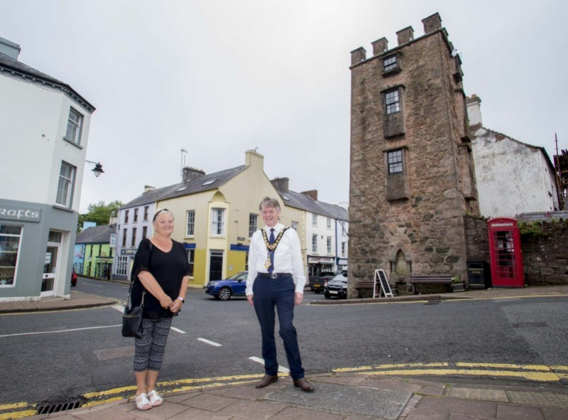 Bernie Delargy pictured with the Mayor of Causeway Coast and Glens Borough Council Alderman Mark Fielding with the Curfew Tower in the background.