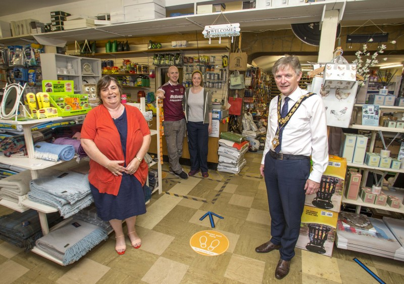 Ronan Delargy and his wife from McAllister's Hardware pictured with the Mayor of Causeway Coast and Glens Borough Council Alderman Mark Fielding and Mayoress Phyllis Fielding during their recent visit to Cushendall.