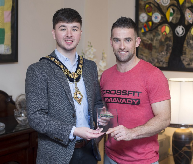 The Mayor of Causeway Coast and Glens Borough Council Councillor Sean Bateson pictured with Michael Walsh from CrossFit Limavady at a recent reception to mark his success at the International Functional Fitness Federation IF3 World Championships in Australia, where he won the 35-39 age category.