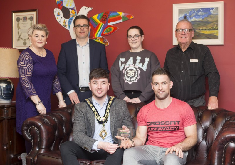 Michael Walsh, winner of the 35-39 age group category at the International Functional Fitness Federation- IF3 World Championships in Australia, pictured with the Mayor of Causeway Coast and Glens Borough Council, Councillor Sean Bateson and family members at a recent reception to celebrate his success.