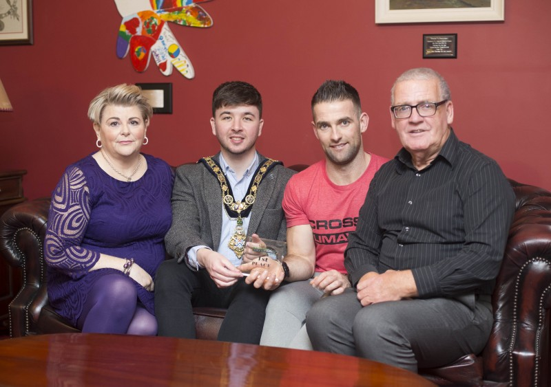 The Mayor of Causeway Coast and Glens Borough Council Councillor Sean Bateson recently hosted a reception for Michael Walsh who took 1st place at the International Functional Fitness Federation- IF3 World Championships in Australia, within the 35-39 age group category. Included in the picture are Michael's mother Christine and father Jessie.
