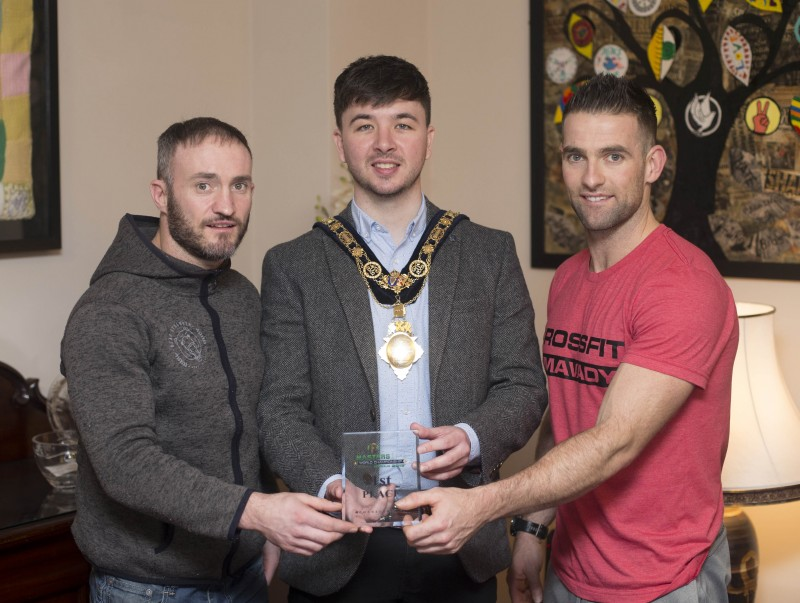 The Mayor of Causeway Coast and Glens Borough Council Councillor Sean Bateson recently hosted a reception for Michael Walsh who took 1st place at the International Functional Fitness Federation- IF3 World Championships in Australia, within the 35-39 age group category. Michael is pictured along with his CrossFit Limavady business partner Andy Chapman.