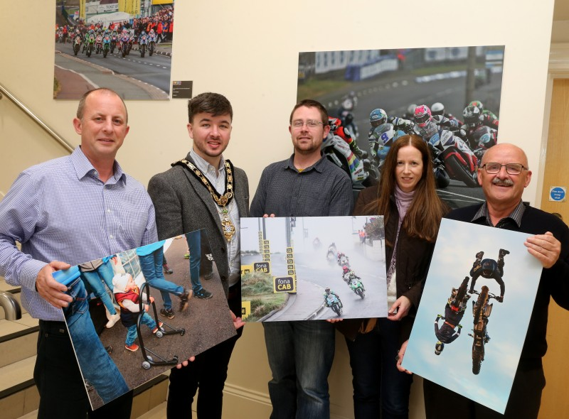 The Mayor of the Causeway Coast and Glens Borough Council, Councillor Sean Bateson pictured with Fergus Mackay, Event Operations Manager of the NW200, Dr Nicholas Wright, Museum Service Community Engagement Officer, Jane Blakely, winner in the Open Category and Wilbert McIlmoyle, one of the People's Choice winners in this year's 'Capture the Moment' International NW 200 photography competition.