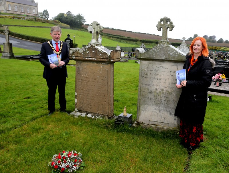 The Mayor of Causeway Coast and Glens Borough Council Alderman Mark Fielding and Rosemary Henderson who wrote the book, pictured at the grave of Sister Molly McGinnis.