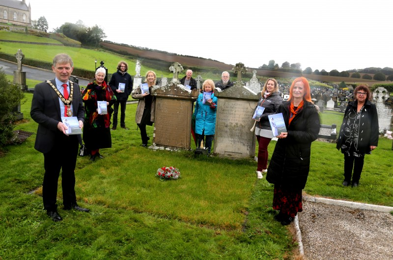 Alderman Mark Fielding, Mayor of Causeway Coast and Glens Borough Council, and Rosemary Henderson, were joined by Sarah-Jane Goldring, Peace IV Co-ordinator, Helen Perry, Museum Services Development Manager, Joanne Honeyford, Museum Officer, and family and friends at the book launch in St Finlough's Graveyard, Ballykelly.