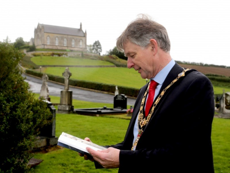 The Mayor of Causeway Coast and Glens Borough Council Alderman Mark Fielding looks through his copy of The Search For Molly: An Irishwoman in the Great War 1914-1918.​