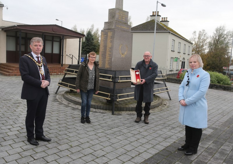John Boyd and Christine Hodges pictured at Limavady War Memorial as they accept a silver Poppy of Remembrance on behalf of their late father Royal Navy Able Seaman Maurice Boyd who passed away earlier this year from the Mayor of Causeway Coast and Glens Borough Council Alderman Mark Fielding and Veterans' Champion Councillor Michelle Knight McQuillan.