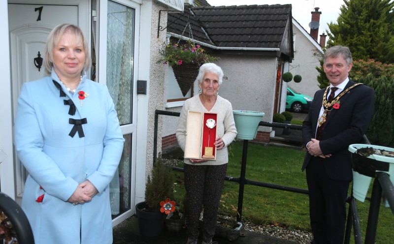 Women's Auxiliary Air Force Leading Aircraftwoman Margaret Robertston receives her silver Poppy of Remembrance from the Mayor of Causeway Coast and Glens Borough Council, Alderman Mark Fielding, and Veterans' Champion Councillor Michelle Knight McQuillan.