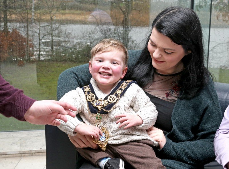 Three-year-old Dáithí MacGabhann smiles for camera while wearing the Mayor's chain of office during the event in Cloonavin to raise awareness about organ donation and the Donate4Dáithí campaign.