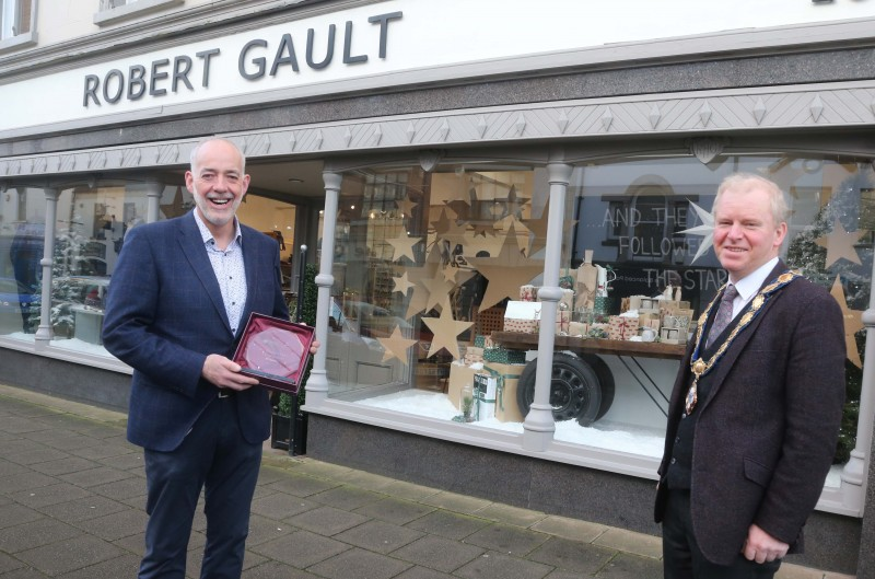 Robert Gault's was the winner of the Best Christmas Window in Ballymoney. Deputy Mayor of Causeway Coast and Glens Borough Council Alderman Tom McKeown presented the prize to Jonathan Gault.