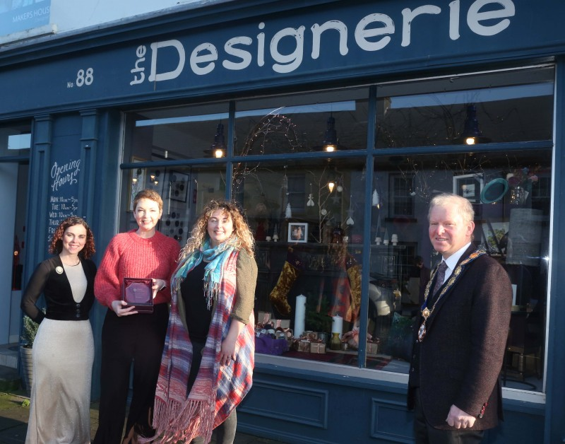 The Designerie was the winner of the Best Christmas Window in Bushmills. Deputy Mayor of Causeway Coast and Glens Borough Council Alderman Tom McKeown presented the prize to Leeann Irwin, Claire McDowell and Sarah Mackay.