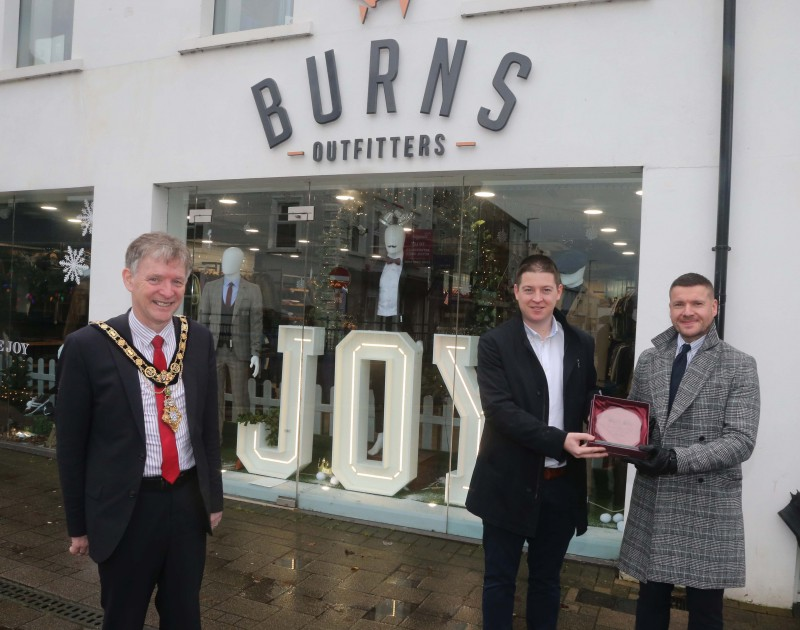 Burns Outfitters was the winner of the Best Christmas Window in Coleraine and the Mayor of Causeway Coast and Glens Borough Council Alderman Mark Fielding presented the award to Jamie Burns and Michael Moffatt .