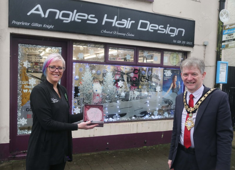 Angles Hair Design was the winner of the Best Christmas Window in Garvagh and the Mayor of Causeway Coast and Glens Borough Council Alderman Mark Fielding presented the award to Gillian Knight.