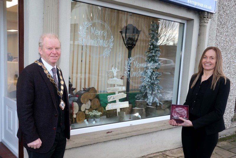 Kerr Insurance Group was the winner of the Best Christmas Window in Kilrea. Deputy Mayor of Causeway Coast and Glens Borough Council Alderman Tom McKeown presented the prize to Office Manager Bernie Downey.