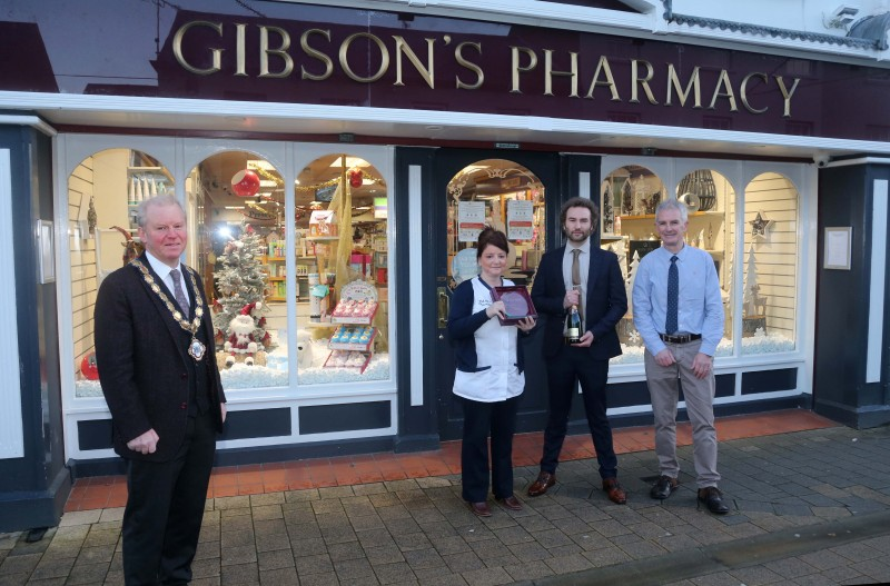 Gibson's Pharmacy was the winner of the Best Christmas Window in Limavady. Deputy Mayor of Causeway Coast and Glens Borough Council presented the prize to Jenny Miller, Sean Devlin and David Gibson.