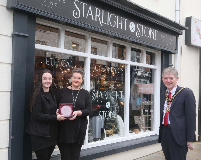 Starlight & Stone was the winner of the Best Christmas Window in Portrush and the Mayor of Causeway Coast and Glens Borough Council Alderman Mark Fielding presented the award to Ellen and Maryrose Stewart.