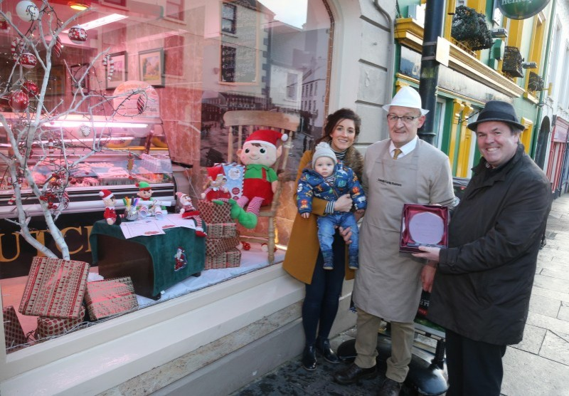 Terence Donnelly's Butchers on Ann Street was the winner of Causeway Coast and Glens Borough Council's Christmas window competition in Ballycastle. Terence is pictured receiving his award from Town and Village Officer Shaun Kennedy alongside his daughter Bronagh and grandson Ollie.