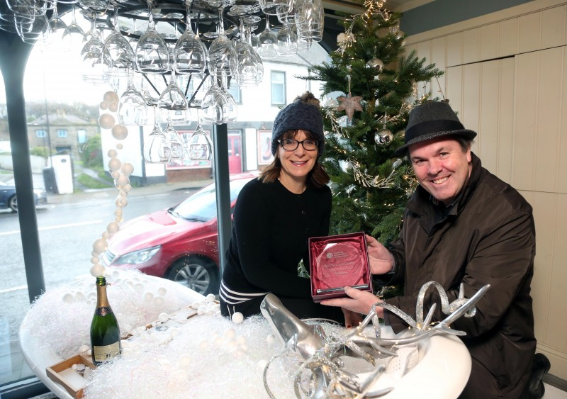 The French rooms on Main Street Bushmills was the winner of Causeway Coast and Glens Borough Council's Christmas window competition in Bushmills. Stella Bolton is pictured receiving the award from Town and Village Officer Shaun Kennedy.