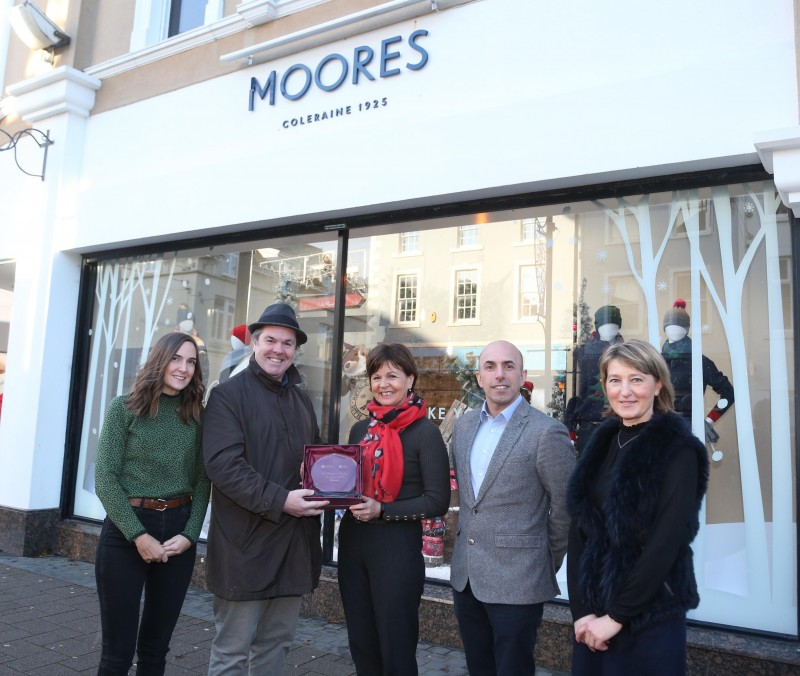 Moores on Church Street Coleraine was the winner of Causeway Coast and Glens Borough Council's Christmas window competition in Coleraine. Pictured (L-R) are Layla Adams, SK, Lorna Gordon, Simon Colquhoun and Vera Duffy, receiving the award from Town and Village Officer Shaun Kennedy.