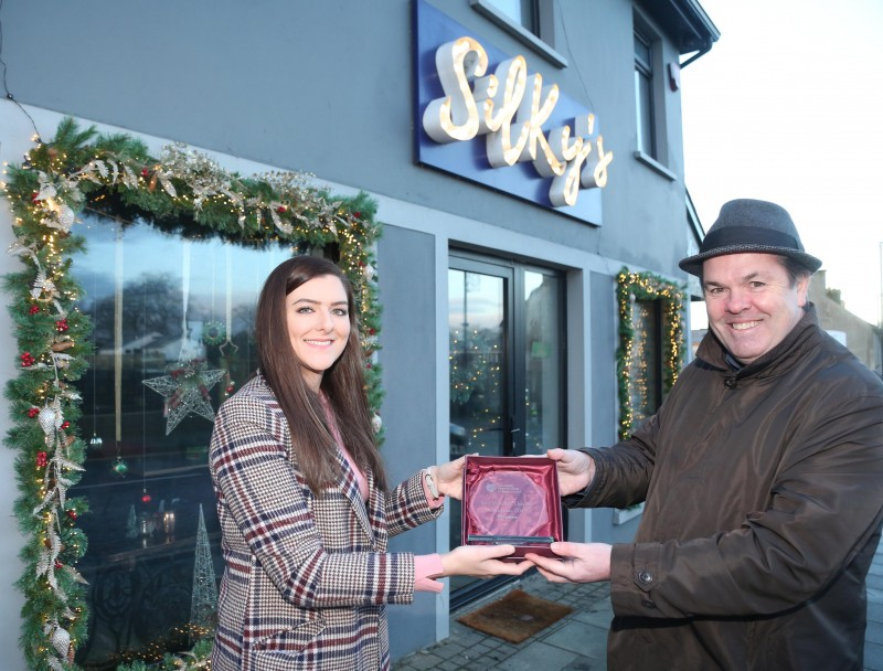 Silky's Bistro on Main Street Dungiven was the winner of Causeway Coast and Glens Borough Council's Christmas window competition in Dungiven. Rachael O'Connor is pictured receiving the award from Town and Village Officer Shaun Kennedy.
