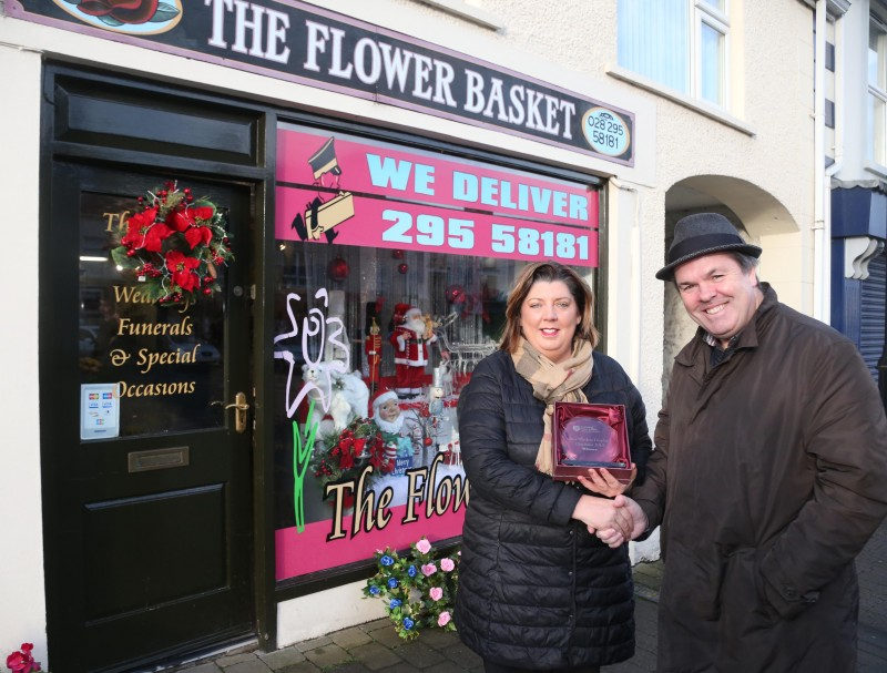 The Flower Basket on Main Street Garvagh was the winner of Causeway Coast and Glens Borough Council's Christmas window competition in Garvagh. Gillian McGarrell is pictured receiving the award from Town and Village Officer Shaun Kennedy.