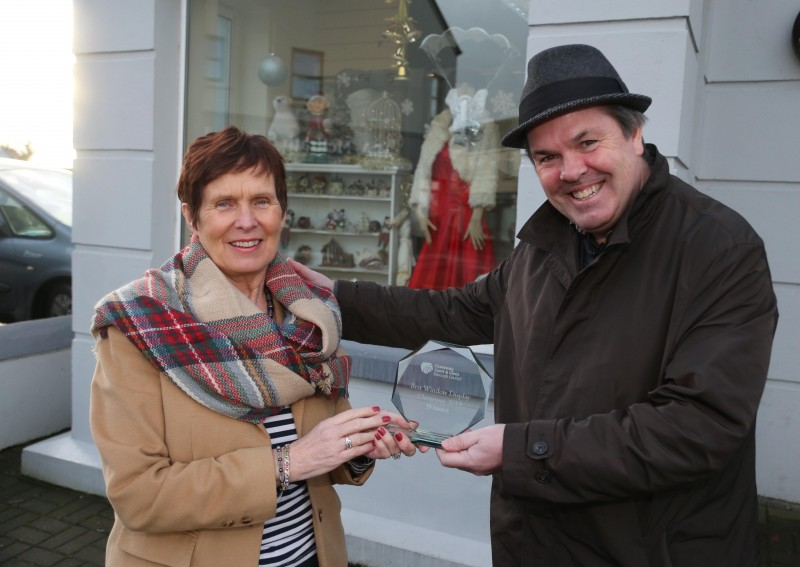 St. Vincent de Paul charity shop on Maghera Street Kilrea was the winner of Causeway Coast and Glens Borough Council's Christmas window competition in Kilrea. Eileen McShane is pictured receiving the award from Town and Village Officer Shaun Kennedy.