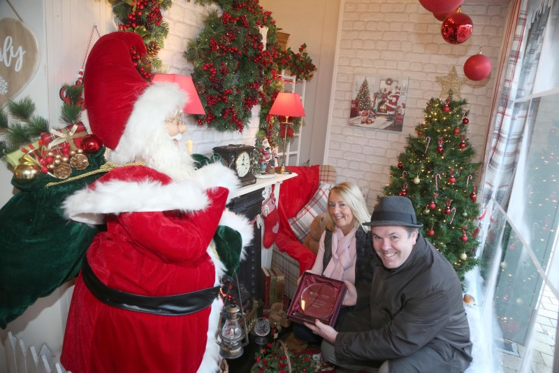 Lucy Goose on Market Street Limavady was the winner of the Causeway Coast and Glens Borough Council's Christmas window competition in Limavady. Patricia Kirkpatrick is pictured receiving the award from Town and Village Officer Shaun Kennedy.